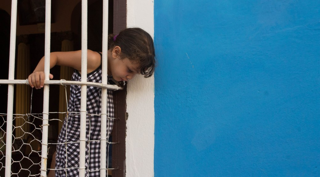 Spit trinidad cuba little girl travel street photography