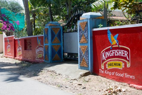 Advertisements for Kingfisher, the most popular beer.  While the beer itself isn't nationalized, all alcohol sales in Kerala are public.