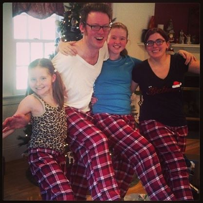 Goofing around with my brother and cousins on Christmas morning.