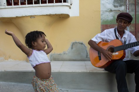 A girl dances to guitar in Trinidad.  I'm feeling like her after hearing this news!