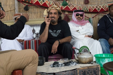 Arab men smoking and drinking tea in a tent in Doha, Qatar the Middle East