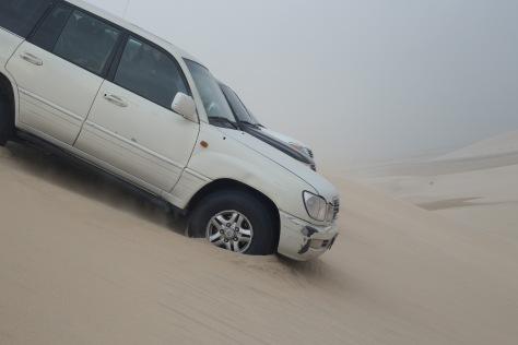 Cars in dunes in the desert in Qatar in the Middle East